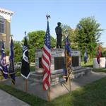 Image of the war memorial with surrounding flags, from the side