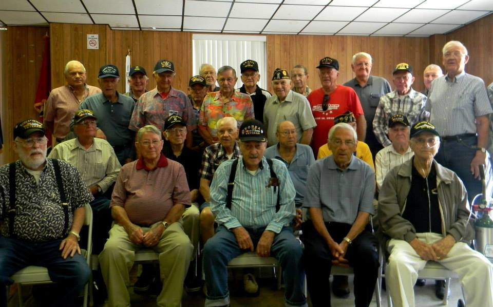 Image of all the attending veterans, sitting and standing together