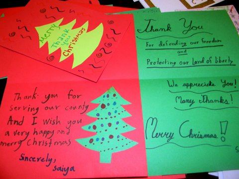 Image of red and green carsd, from children, thanking veterans, merry Christmas, cut outs of trees